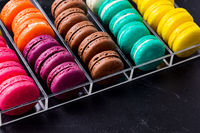 Colorful macarons cookies in the acrylic box