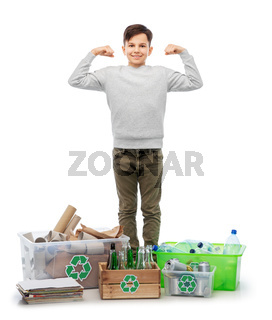 smiling boy sorting paper, metal and plastic waste