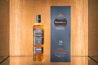 Rare, aged 21 years Bushmills whiskey with a box on illuminated display in distillery shop