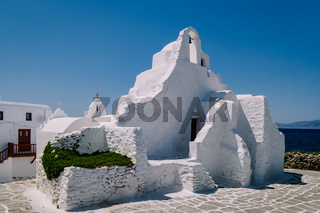Mykonos Greece , old church of the old town of Mykonos with tourist in the street