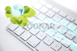 White computer keyboard with 'earth' button