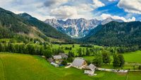 Aerial view of Alpine valley with farmhouse in Jezersko, Slovenia