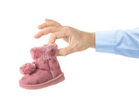 Hand with child shoe
