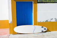 Surfboard old building wall surfing