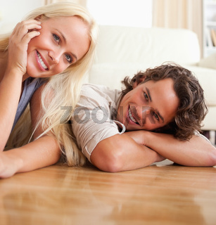 Close up of a couple lying on the floor