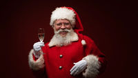 Santa Claus drinking champagne