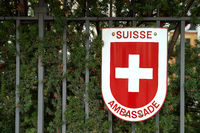 Warsaw, Poland, Nov 15, 2018: Swiss coat of arms on the Swiss Embassy fence