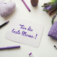 German For the best mom as brush lettering on a mother's day greeting card