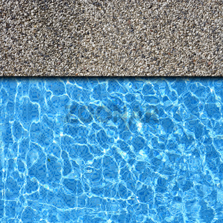 white sand stone pavement with pool edge background