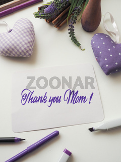 Thank you mother as brush lettering on a mother's day greeting card