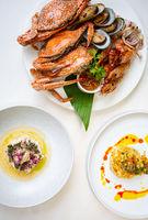 Set of Thai seafood popular menu setting on white table.