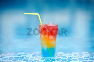Cocktail at the edge of the swimming pool