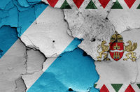 flags of District XIX. (Kispest) and Budapest painted on cracked wall