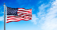 The national flag of the United States of America waving in the wind.