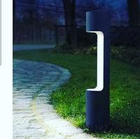Creative pillar on sidewalk with lighting.