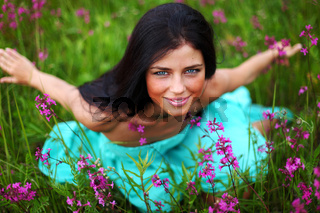 woman on pink flower field close portrait
