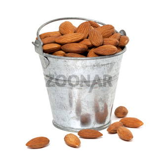 Tin bucket full of almonds