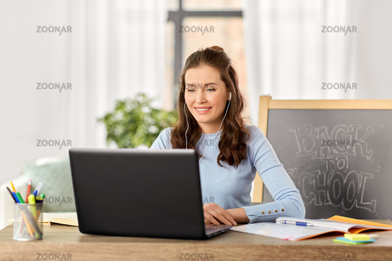 teacher with laptop having online class at home