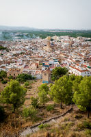 Top view from the castle 'Santa Anna' on the Spanish old town with the church 'San Roque', Oliva, Spain