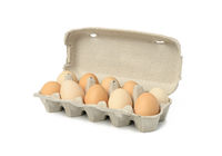 fresh whole brown eggs in paper packaging