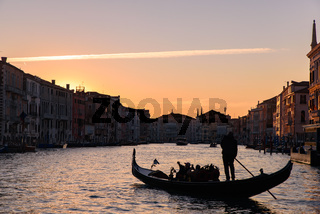 Silhouette of gondola on the Grand Canal at sunrise / sunset time, Venice, Italy