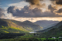 Black Valley illuminated by sunlight from dramatic sky at sunset