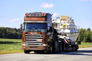 Truck Transports Boat as Oversize Load