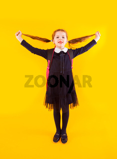 The joyful schoolgirl is ready back to school