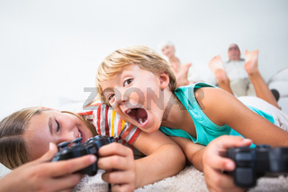 Brother and sister playing video games and having fun