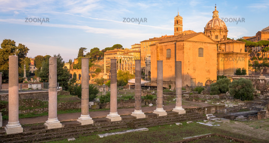 Sunrise light with blue sky on Roman ancient architecture in Rome, Italy