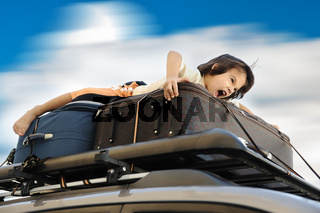 Little boy traveling on the top of the car