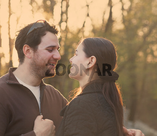 Happy smiling couple in the autumn garden