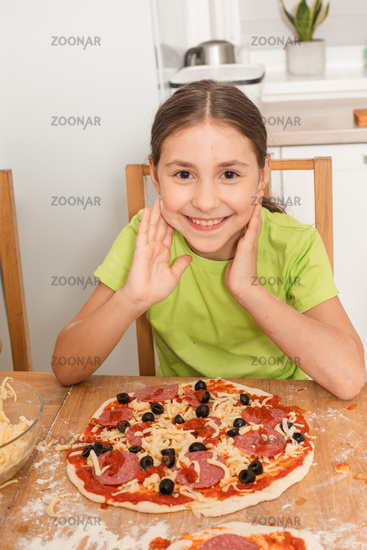 the little girl cooked her favorite pizza