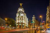 Gran Via and Metropolis Building in Madrid at night