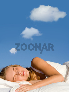 woman sleeping dreaming with dream bubbles