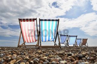 Empty deckchairs on brighton beach