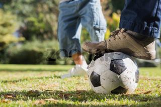 Child kicking the ball