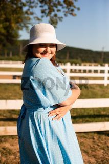 Candid woman in hat at farmland enjoy the summer