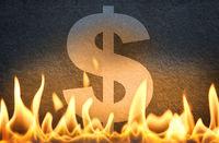 US dollar symbol burning in fire flames