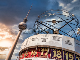 Berlin Television Tower, low angle with World clock in forefront. Sunset with cloudy sky