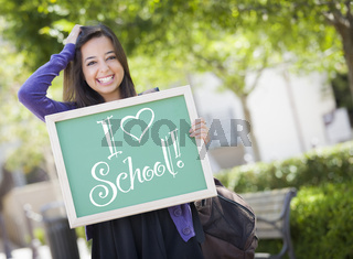 Mixed Race Female Student Holding Chalkboard With I Love School