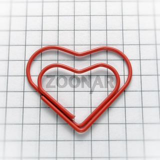 Closeup of heart shaped red paper clip