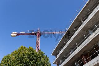Crane and Apartment Building under construction. Construction site