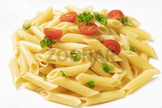 Plate of italian pasta, penne rigate with tomatoes