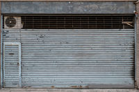 vintage store or shop with closed metal shutter  -