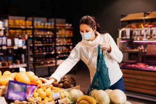 Young woman choosing eco-friendly way of shopping