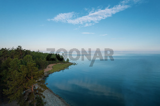 Summertime imagery of Lake Baikal in morning is a rift lake located in southern Siberia, Russia. Baikal lake summer landscape view. Drone's Eye View.