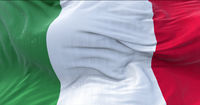 The tricolor flag of Italy waving in the wind