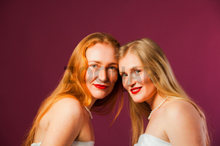 Two attractive women with bright red lipstick
