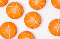 Many basketballs ona bright background